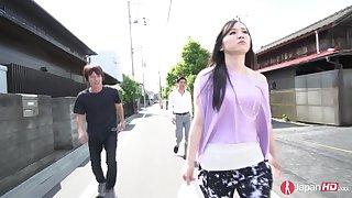 Slutty Japanese babe Yuka Wakatsuki is fucked by two dudes