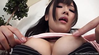 Sexy Asian masturbates in the district apart from her fingers increased by a dildo
