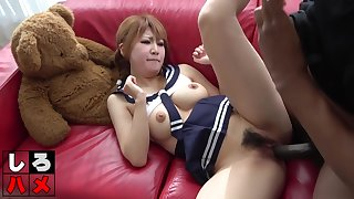 Pigtailed, Asian babe is wearing her school uniform while riding a big, black in person stick